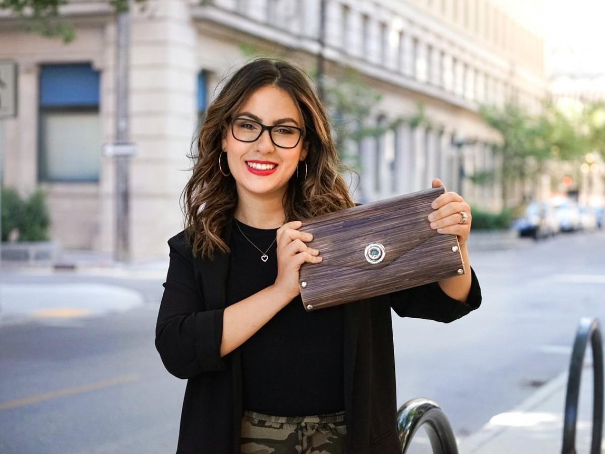 Meet the Tourism Winnipeg Team: Grace Hicks - Grace Hicks, Business Development Manager, Tourism Winnipeg shows off one of her favourite local gift picks -- a SOL Designs purse.